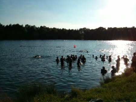 Swimmers preparing for the open water swim in ideal conditions