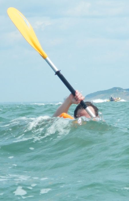A kayaker plays inthe swell by the Needles, Isle of Wight
