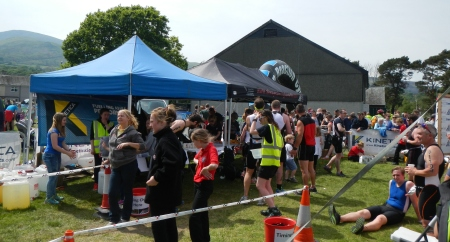Welcoming marshals, free food, drink, and a Slateman 2014 coaster made of Welsh slate await finishers
