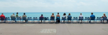 People gaze out to the calm waters of the Med, the day before Ironman Nice 2014.