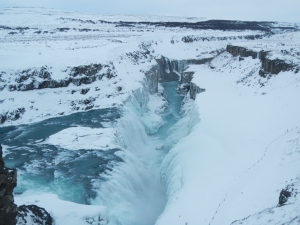 The waterfall at Gullfoss flows throughout winter, but you can see where the spray has frozen on the far side.